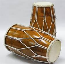 Dholak. This is a folk instrument used in Keertan, Bhajan, Sufi Islamic music and other regional styles. Some players do a lot of Tabla- or Mridangam-style  pitch bending on the bass side of the Dholak.