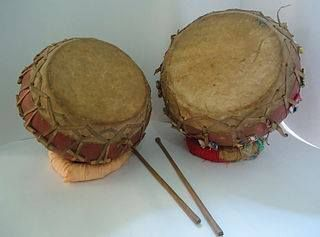 Naqqara (Nagara) Kettledrums often in pairs, the smaller female and the larger male, made of earth, wood or metal, beaten with sticks vary in size from a few inches to feet in diameter. It should be of Persian origin.