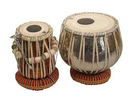 Tabla is the most famous Indian drum, which actually consists of a tuned pair of drums - one for bass tones usually made of metal and another for higher tones made of wood, both overlaid with a black patch of iron oxide, gum arabic & other unknown substances in the centre. Under medieval Islamic influence in the northern part of the subcontinent, Middle Eastern hand percussion especially the Darbuka could have influenced Indian rhythm. This synthesis culminated in the development (possibly from the PakhAwaj) of the Tabla. Some scholars  suggest that an intermediate form called the Dukkar existed. Tabla is also popular among Western fusion musicians.
