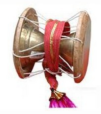 The udukai or uduku is a membranophone instrument used in folk music and prayers in Tamil Nadu and it is originated as well. Its shape is similar to other Indian hourglass drums, having a small snare stretched over one side. The udaku is played with the hand and the pitch may be altered by squeezing the lacing in the middle. The damru in the hands of Lord Shiva is also referred to as udukai.
